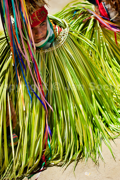 """A Cucambas dancer kneels in the religious procession in Atanquez, Sierra Nevada, Colombia, 3 June 2010. A colorful celebration of Corpus Christi is held in the Kankuamo Indians territory every year. """"The Dance of the Devils"""" is an ancient tradition kept for centuries on the Colombia's Caribbean coast. This Christian religious event usually coincides with the summer solstice, which has always been the key point for the native cultures and for the black African slaves. Due to this confluence, the Kankuamo myths, the African animistic rites and other Pre-Columbian features have blended with the Spanish Catholic festival into a lively spectacle."""