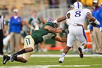 Kansas wide receiver Nick Harwell (8) pushes off Baylor safety Chance Waz (18) during NCAA football game, Saturday, November 01, 2014 in Waco, Tex. Baylor defeated Kansas 60-14. (Mo Khursheed/TFV Media via AP Images)
