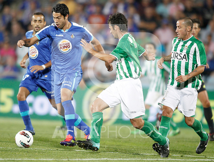 Getafe's Miku against Real Betis de Sevilla's Mario Alvarez during La Liga Match. September 26, 2011. (ALTERPHOTOS/Alvaro Hernandez)