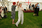 Chelsea Pensioners London. The Founders Day annual garden party London England. 2006. Women dancing together.