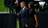 United States President Barack Obama and first lady Michelle Obama arrive at a memorial for the victims of the Washington Navy Yard shooting at the Marine Barracks, September 22, 2013 in Washington, D.C. The President and First Lady also visited with families of the victims. <br /> Credit: Olivier Douliery / Pool via CNP