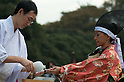 November 3, 2011, Tokyo, Japan - A woman musketeer dressed in traditional attire receives ritual rice-wine at the end of a Martial Arts demonstration held at Meiji shrine to celebrate Japan's National Culture Day. (Photo by Bruce Meyer-Kenny/AFLO) [3692]