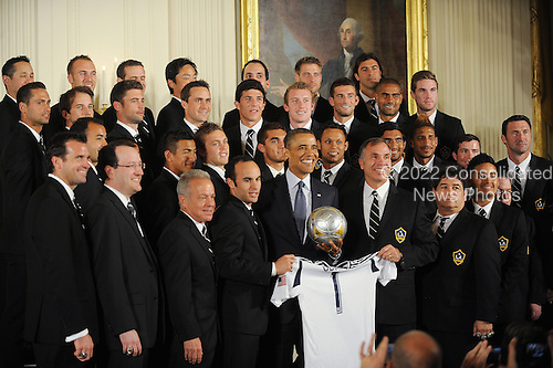 United States President Barack Obama poses with the Major League Soccer champion LA Galaxy to the White House to honor their 2012 championship seasons in a ceremony in the East Room of the White House March 26, 2013 in Washington, DC. .Credit: Olivier Douliery / Pool via CNP