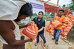 Staff from ICCO Cooperation distribute food to Rohingya refugees in the Chakmarkul Refugee Camp near Cox's Bazar, Bangladesh, where they and other members of the ACT Alliance provide humanitarian support for the refugees. <br /> <br /> More than 600,000 Rohingya have fled government-sanctioned violence in Myanmar for safety in Bangladesh.