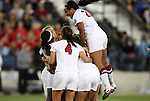 02 December 2011: Stanford's Chioma Ubogagu (left) celebrates scoring the first goal of the game with teammates including Mariah Nogueira (20) who jumps on the pile. The Stanford University Cardinal played the Florida State University Seminoles at KSU Soccer Stadium in Kennesaw, Georgia in an NCAA Division I Women's Soccer College Cup semifinal game.
