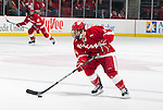 Wisconsin Badgers forward Jefferson Dahl (14) handles the puck during an NCAA hockey game against the Alabama Huntsville Chargers at the Kohl Center in Madison, Wisconsin on October 15, 2010. The Badgers won 7-0. (Photo by David Stluka)