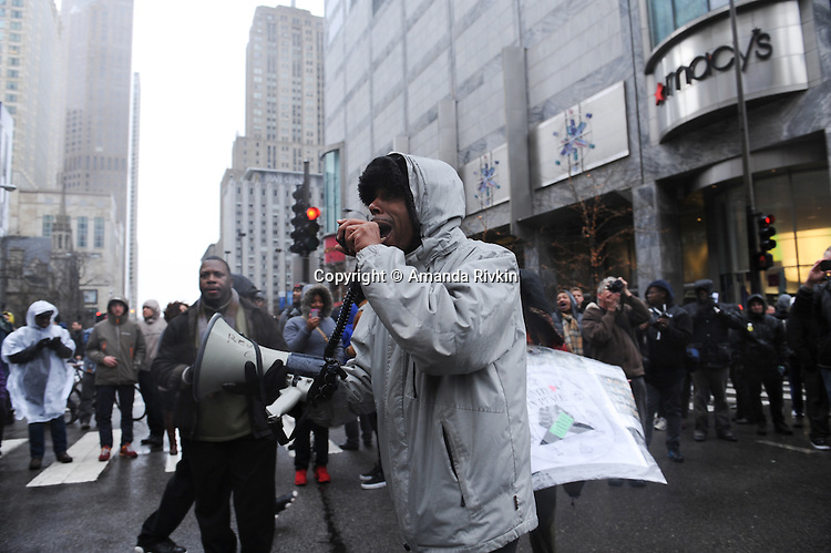 """Mark Clements, a victim of police torture who confessed to a crime he did not commit when he was 16 and was wrongly incarcerated for it for 28 years, speaks about his experiences with the Chicago Police and the effect it has had on his life during protests on Michigan Avenue, Chicago's """"Magnificent Mile"""" and longest shopping street, to protest three days after the release of a dash cam video documenting the killing of Laquan McDonald by Chicago Police Officer Jason Van Dyke, who has been charged with his murder, on Black Friday, the busiest shopping day of the year, in Chicago, Illinois on November 27, 2015.  Van Dyke fired 16 shots at McDonald and fired 13 of those shots after McDonald was on the ground and only stopped after his colleague told him to stand down; a journalist for outlet DNA Info sued the City of Chicago for release of the dash cam video, which the city released only after ordered to do so by a judge last week."""