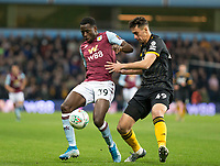 30th October 2019; Villa Park, Birmingham, Midlands, England; English Football League Cup, Carabao Cup, Aston Villa versus Wolverhampton Wanderers; Keinan Davis of Aston Villa controls the ball as Maximilian Kilman of Wolverhampton Wanderers comes in to tackle - Strictly Editorial Use Only. No use with unauthorized audio, video, data, fixture lists, club/league logos or 'live' services. Online in-match use limited to 120 images, no video emulation. No use in betting, games or single club/league/player publications