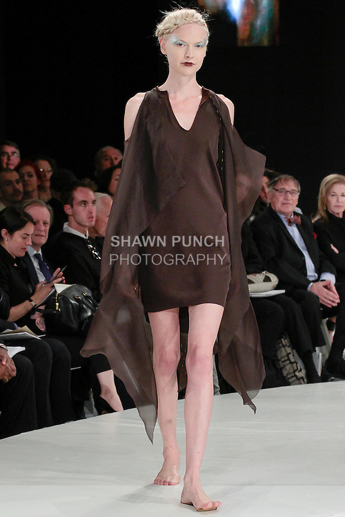 Model walks runway in an outfit by Catherine Young, during the 2013 Pratt Institute Fashion Show, on April 25, 2013.