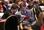 Elliot Malin and Stephen Wood monitor election results at the Washoe GOP Election Party, in Reno, Nev., on Tuesday, Nov. 4, 2014. (AP Photo/Cathleen Allison)
