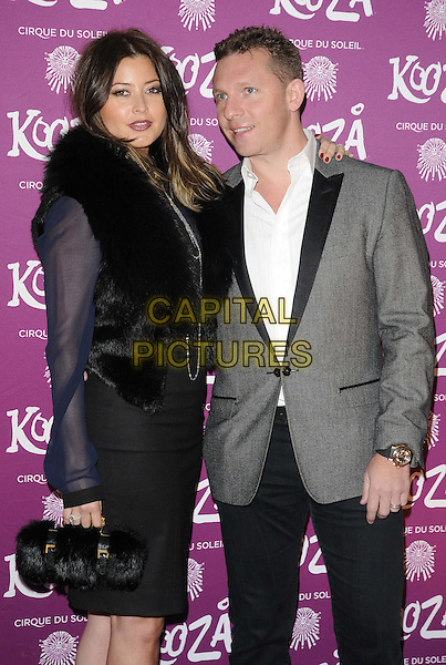 "Holly Valance & Nick Candy.VIP Night for Cirque du Soleil's new production, ""Kooza"" at the Royal Albert Hall, London, England..January 8th 2013.half length white shirt grey gray suit jacket fur blue black dress bag purse married husband wife.CAP/CJ.©Chris Joseph/Capital Pictures."