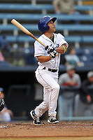 Asheville Tourists designated hitter Kyle Von Tungeln #1 swings at a pitch during a game between the Hickory Crawdads and the Asheville Tourists at McCormick Field on April 17, 2013 in Asheville, North Carolina. The Crawdads won the game 6-5. (Tony Farlow/Four Seam Images).