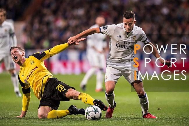 Lucas Vazquez (r) of Real Madrid battles for the ball with Lukasz Piszczek of Borussia Dortmund during the 2016-17 UEFA Champions League match between Real Madrid and Borussia Dortmund at the Santiago Bernabeu Stadium on 07 December 2016 in Madrid, Spain. Photo by Diego Gonzalez Souto / Power Sport Images