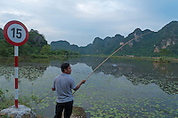 Ninh Binh, man fishing at a small Pond. Vietnam