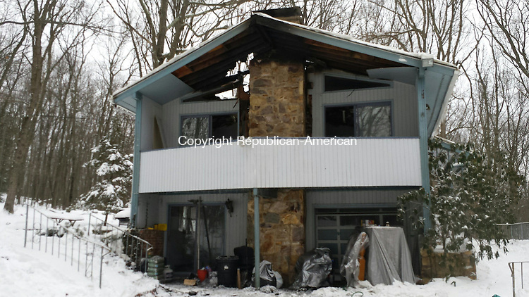 CHESHIRE -  A family of four was displaced Tuesday after a fire heavily damaged their home at 110 Mayview Ave.