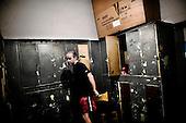 Warsaw 04.2009 Poland<br /> Changing room of boxing section in Gwardia Warszawa ( Warsaw Guard ).<br /> Since the early 50' ties &quot;Gwardia&quot; has been famous for bringing up world boxing champions. The famed sports hall located by pl. Zelaznej Bramy in Warsaw witnessed trainings of Jerzy Kulej, the Skrzeczowie brothers, last Polish olympic champion Jerzy Rybicki or its most recent star Krzysztof &quot;Diablo&quot; Wlodarczyk. The club prides of numerous sport achievements, among others, 15 olympic medals (6 gold), over 60 medals from European and World Championships and over 100 from Championships of Poland.<br /> Today, only three small training halls remain from the former times of glory.<br /> One of the most famous in Polish history boxing section of Warsaw's &quot;Gwardia&quot; awaits its liquidation. This &quot;Mecca&quot; of Polish boxing is to be replaced by a huge supermarket,  decisions imposed by Warsaw authorities.<br /> ( Photo: Adam Lach / Napo Images )<br /> <br /> Juz od wczesnych lat 50. Gwardia slynela z wychowywania swiatowych mistrzow bokserskich. W hali przy pl. Zelaznej Bramy trenowali Jerzy Kulej, bracia Skrzeczowie, ostatni polski mistrz olimpijski w boksie Jerzy Rybicki czy obecna gwiazda ringu Krzysztof &quot;Diablo&quot; Wlodarczyk. Klub moze poszczycic sie wieloma osiagnieciami sportowymi, do kt&oacute;rych przede wszystkim zaliczyc nalezy: 15 medali olimpijskich (w tym 6 zlotych), ponad 60 medali Mistrzostw Swiata i Europy i ponad 1000 medali Mistrzostw Polski. Teraz z dawnej swietnosci pozostaly zaledwie trzy male salki. Jedna z najslyniejszych w historii Polski sekcja bokserska Gwardii Warszawa ma byc zlikwidowana. Decyzja wladz Warszawy, te swego rodzaju mekke polskiego boksu ma zastapic wielki market<br /> (Fot Adam Lach / Napo Images )