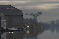 General view of the River Clyde at Glasgow showing a tall crane.