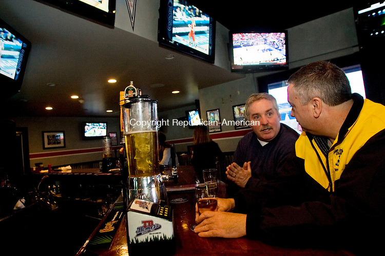 SOUTHINGTON, CT - 12 MARCH 2010 -031210JT01-<br /> John Buckridge, left, of Southington, talks to friend Bruce Bush of Bristol at the bar of TD Homer's Sports Bar in Southington on Friday. <br /> Josalee Thrift Republican-American