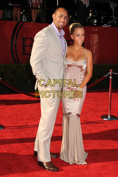 Hank Baskett and Kendra Wilkinson-Baskett.2011 ESPY Awards - Arrivals held at Nokia Theatre L.A. Live, Los Angeles, California, USA..July 13th, 2011.full length grey gray suit purple shirt maxi dress pink silk satin cleavage   married husband wife.CAP/ADM/BP.©Byron Purvis/AdMedia/Capital Pictures.