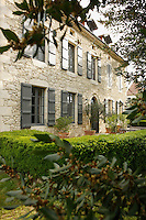 The mellow stone walls of the facade of the manor house date from the 18th century