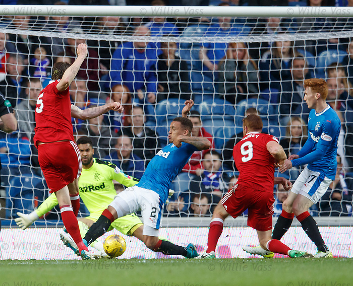 James Tavernier puts in a last gasp tackle on Ash Taylor to deny the goalbound shot and deflect it away