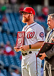 "26 September 2018: Washington Nationals relief pitcher Sean Doolittle receives the ""Good Guy"" Award from MASN Reporter Mark Zuckerman prior to a game against the Miami Marlins at Nationals Park in Washington, DC. The Nationals defeated the visiting Marlins 9-3, closing out Washington's 2018 home season. Mandatory Credit: Ed Wolfstein Photo *** RAW (NEF) Image File Available ***"