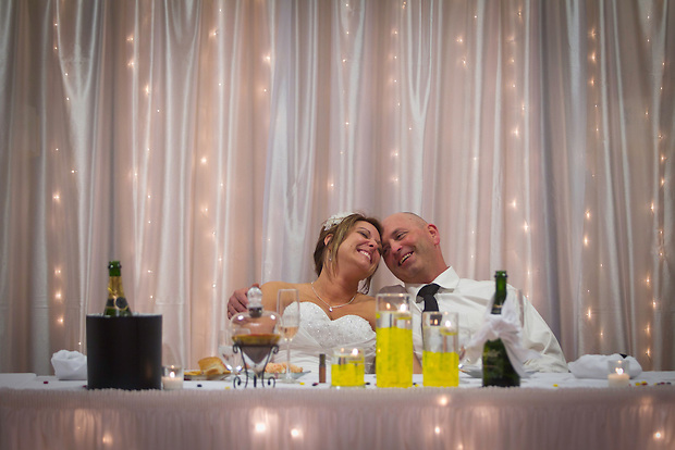 Heather Jacobs and Dan Moen share a joyous moment relaxing at their wedding reception on April 16.  More than five yeas after losing her first husband in a 2006 plane crash, Heather followed her late husband's wishes and remarried.