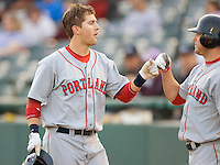 Reid Engel #31 of the Portland Sea Dogs is congratulated by a teammate after hitting a home run at Waterfront Park May 12, 2009 in Trenton, New Jersey. (Photo by Brian Westerholt / Four Seam Images)