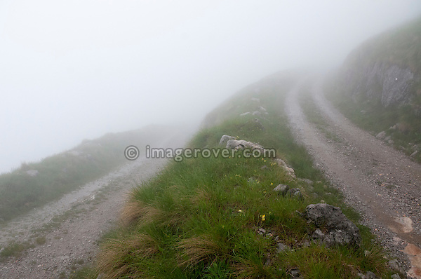 Bad weather with fog on the unsurfaced Stol mountain pass from Sedlo to Zaga in the Julian Alps, Slovenia.