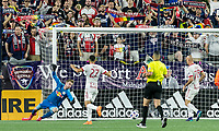 Foxborough, Massachusetts - June 2, 2018: In a Major League Soccer (MLS) match, New England Revolution (blue/white) defeated New York Red Bulls (white), 2-1, at Gillette Stadium.<br /> Crossing ball gets by Ryan Meara and reaches Teal Bunbury for a goal.