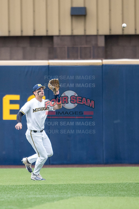Michigan Wolverines outfielder Jonathan Engelmann (2) makes a catch against the Maryland Terrapins on April 13, 2018 in a Big Ten NCAA baseball game at Ray Fisher Stadium in Ann Arbor, Michigan. Michigan defeated Maryland 10-4. (Andrew Woolley/Four Seam Images)