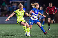 Allston, MA - Sunday, April 24, 2016: Seattle Reign FC midfielder Kim Little (8) and Boston Breakers player McCall Zerboni (77). The Boston Breakers play Seattle Reign during a regular season NSWL match at Harvard University.