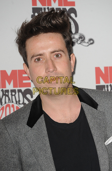 Nick Grimshaw.The NME Awards 2012, O2 Academy Brixton, Stockwell Rd., London, England..29th February 2012.headshot portrait black grey gray.CAP/WIZ.© Wizard/Capital Pictures.