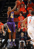 Jan. 2, 2011; Charlottesville, VA, USA; LSU Tigers guard Aaron Dotson (45) grabs a rebound in front of Virginia Cavaliers guard Jontel Evans (1) during the game at the John Paul Jones Arena. Virginia won 64-50. Mandatory Credit: Andrew Shurtleff-