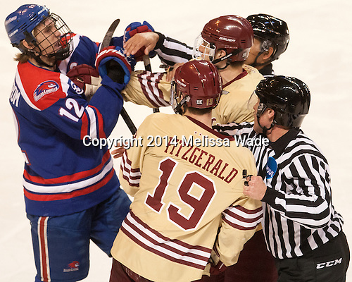 Josh Holmstrom (UML - 12), Ryan Fitzgerald (BC - 19), Steven Santini (BC - 6) - The Boston College Eagles defeated the University of Massachusetts Lowell River Hawks 4-3 in the NCAA Northeast Regional final on Sunday, March 30, 2014, at the DCU Center in Worcester, Massachusetts.