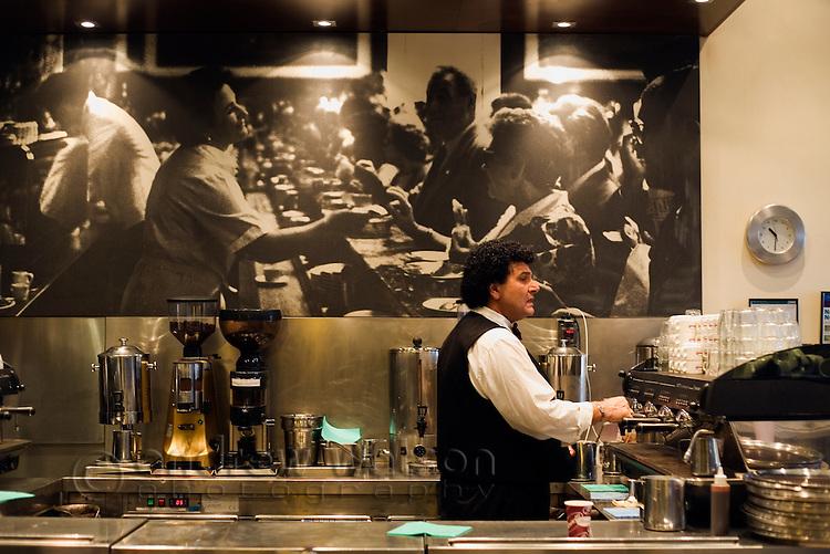 Barista in action at Brunetti cafe in Carlton.  Melbourne, Victoria, AUSTRALIA.