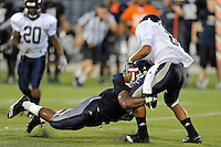12 August 2011:  FIU's Kenneth Dillard (41) sacks Loranzo Hammonds Jr. (8) during a scrimmage held as part of the FIU 2011 Panther Preview at University Park Stadium in Miami, Florida.