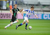 VOETBAL: HEERENVEEN: Abe Lenstra Stadion, 21-10-2012, SC Heerenveen - FC Groningen, Einduitslag 3-0, Filip Djuricic. aan de bal(#9 | SCH), achtervolgt door Maikel Kieftenbeld (GRON) ©foto Martin de Jong