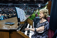 Spring Graduation - first ceremony for the College of Education and the College of Business; playing the organ while graduates file in for the commencement ceremony at Humphrey Coliseum.<br />  (photo by Megan Bean / &copy; Mississippi State University)