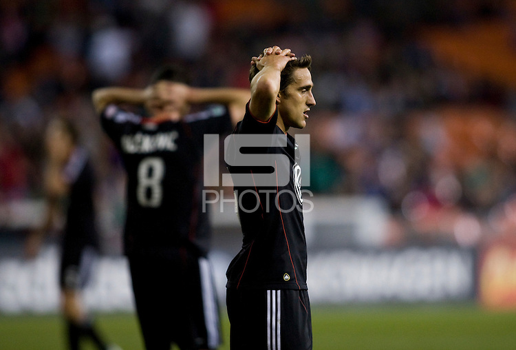 Josh Wolff (16) of D.C. United reacts to a missed goal chance during the game at RFK Stadium in Washington, DC.  D.C. United lost to the New York Red Bulls, 4-0.
