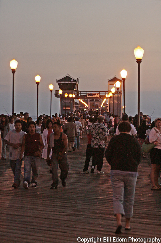 Oceanside Pier is crowded with people on a July evening.