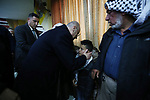 Palestinian Prime Minister Rami Hamdallah offers condolences to the family of Hamdi Naasan, who was killed by Israeli settlers, in al-Mughair village near the West Bank city of Ramallah, January 28, 2019. Nassan was shot killed in clashes with Israeli settlers. Photo by Prime Minister Office