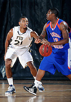 Florida International University guard Richaud Pack (21) plays against Florida Memorial University in an exhibition game .  FIU won the game 86-69 on November 9, 2011 at Miami, Florida. .