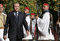 Pictured: Turkey President Recep Tayyip Erdogan walks past a row of Presidential Guards known as Tsoliaded, to the official Presidential Mansion <br /> Re: Turkey's president Recep Tayyip Erdogan has begun a landmark visit to Greece. Thursday 07 December 2017