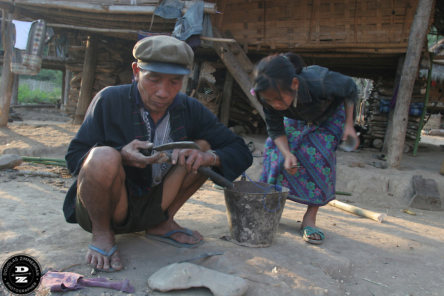 Village life in the village of NamTalan, in the county of Louang Namtha, Laos.  The remote village of Nam Talan, only accessible on foot, is a village of the Kmu and Lanten ethnic groups. Photograph by Douglas ZImmerman.