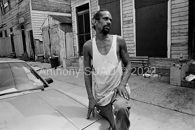 New Orleans, Louisiana.USA.July 29, 2006..Darryl McDaniel, the father of two victims of a quadruple homicide that happened the night before at this place, stands on the street where his sons were shot and killed...A quadruple homicide in the city center happened the night before. Crime is on the rise as residents return looking for work and living in questionable housing conditions. Younger drug lords try to claim territory in the destroyed New Orleans districts nearly one year after hurricane Katrina hit and the levees broke leaving 80% of the city flooded. .