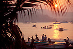 Mexico, Zihuatanejo, Mexico's West coast: Fishing boats returning with catch, sunrise..