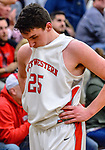 WATERBURY, CT. 14 March 2018-031418BS692 - Zack Penn (25) from Northwestern shows his disappointment along the bench after his team came up short against Kolbe Cathedral at the Div IV semi-finals at Kennedy High School on Wednesday evening. Kolbe went on to defeat Northwestern and advanced to the finals at Mohegan Sun. Bill Shettle Republican-American