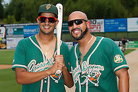 Carlos Lopez (left) and Greensboro Grasshoppers player/coach Jose Ceballos (right) pose for a photo prior to the game against the Kannapolis Intimidators at CMC-NorthEast Stadium on September 1, 2014 in Kannapolis, North Carolina.  The Grasshoppers defeated the Intimidators 7-4.  (Brian Westerholt/Four Seam Images)