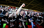 Chris Basham of Sheffield Utd leads the celebration with the fans during the English League One match at Sixfields Stadium Stadium, Northampton. Picture date: April 8th 2017. Pic credit should read: Simon Bellis/Sportimage